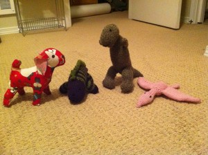stuffed dog and dinosaurs